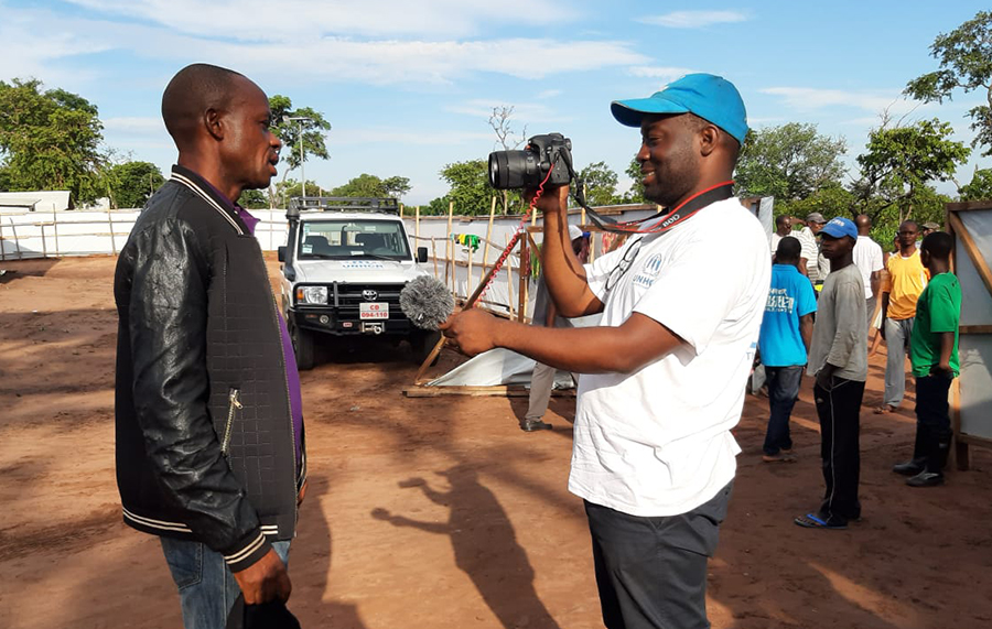 Omotola Akindipe, UN Volunteer Associate Reporting Officer for the UN Refugee Agency (UNHCR) in Angola, interviews refugees on various topics, including mental health and shelter requirements.