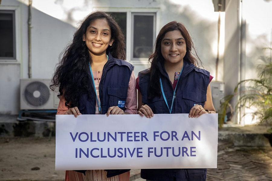 UN Volunteer Site Planner Samara Hamid (right) and UN Volunteer AutoCAD Surveyor Urmi Das, at the office of IOM in Cox's Bazar, Bangladesh.