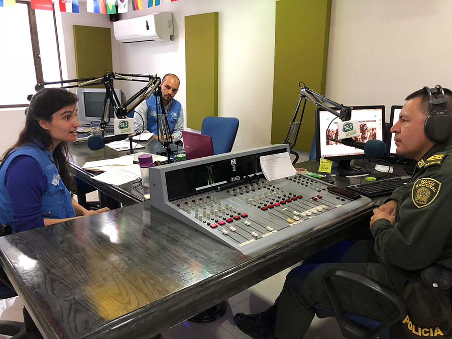 Marco Nardo, UN Volunteer Associate Protection Officer with UNHCR (centre), Vera Quina, Head of UNHCR Field Office of Mocoa (left) and Germain Bravo, Officer at the Putumayo National Police Department at the National Police Radio 93.2 FM, Mocoa, Colombia.