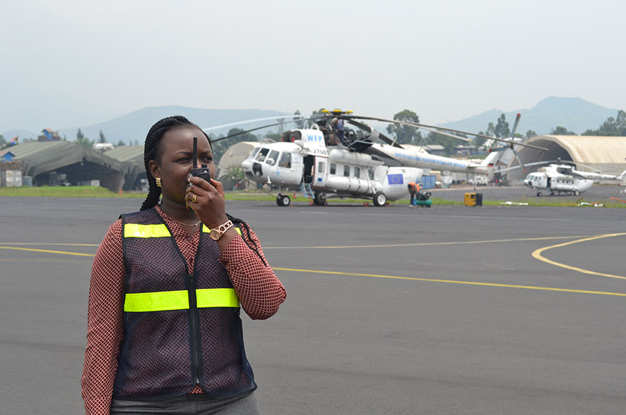 Grace Otieno, UN Volunteer Air Operations Planning Officer in the Movement Control Aviation section of the United Nations Organization Stabilization Mission in the Democratic Republic of Congo, doing a pre-flight check in Goma.