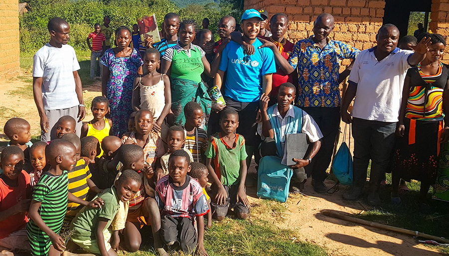 UN Volunteer Monitoring and Evaluation Officer Marco Fayet, here on a community visit, serves with UNICEF in Lubumbashi, DRC.