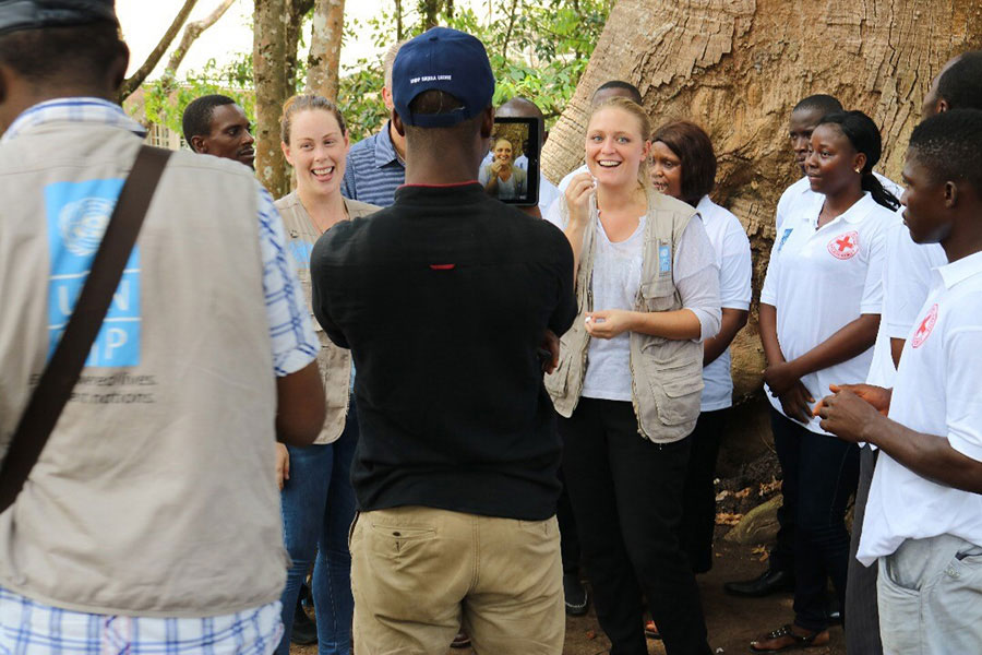 Lynda Buckowski (Ireland) serves as UN Youth Volunteer with UNDP in Sierra Leone (being pictured, facing, right). She manages the Ebola Burial team, together with community volunteers and volunteers from the IFRC.