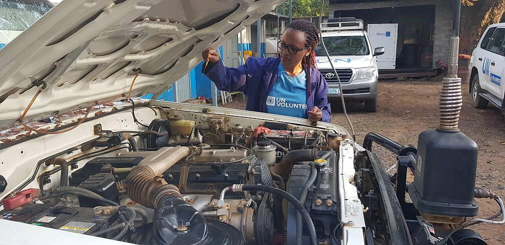 Amabel Nagaba, UN Volunteer Associate Fleet Management Officer, performing a pre-trip inspection for a vehicle going on a road mission.