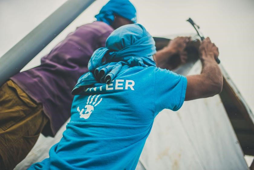 An All Hands volunteer and local Fijian rebuilding a home in Delakado village in Fiji (2016).