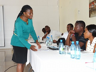 Why i am so enthusiastic to be the unv programme officer in zambia unv un volunteer flavia sembera standing uganda programme officer for the unv field unit in zambia conducts a session during the 2014 retreat for un publicscrutiny Image collections