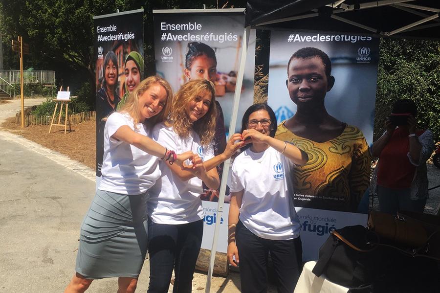 UN Volunteer Kamilia Lahrichi (centre) served as UN Volunteer Associate Public Information Officer with UNHCR in France.