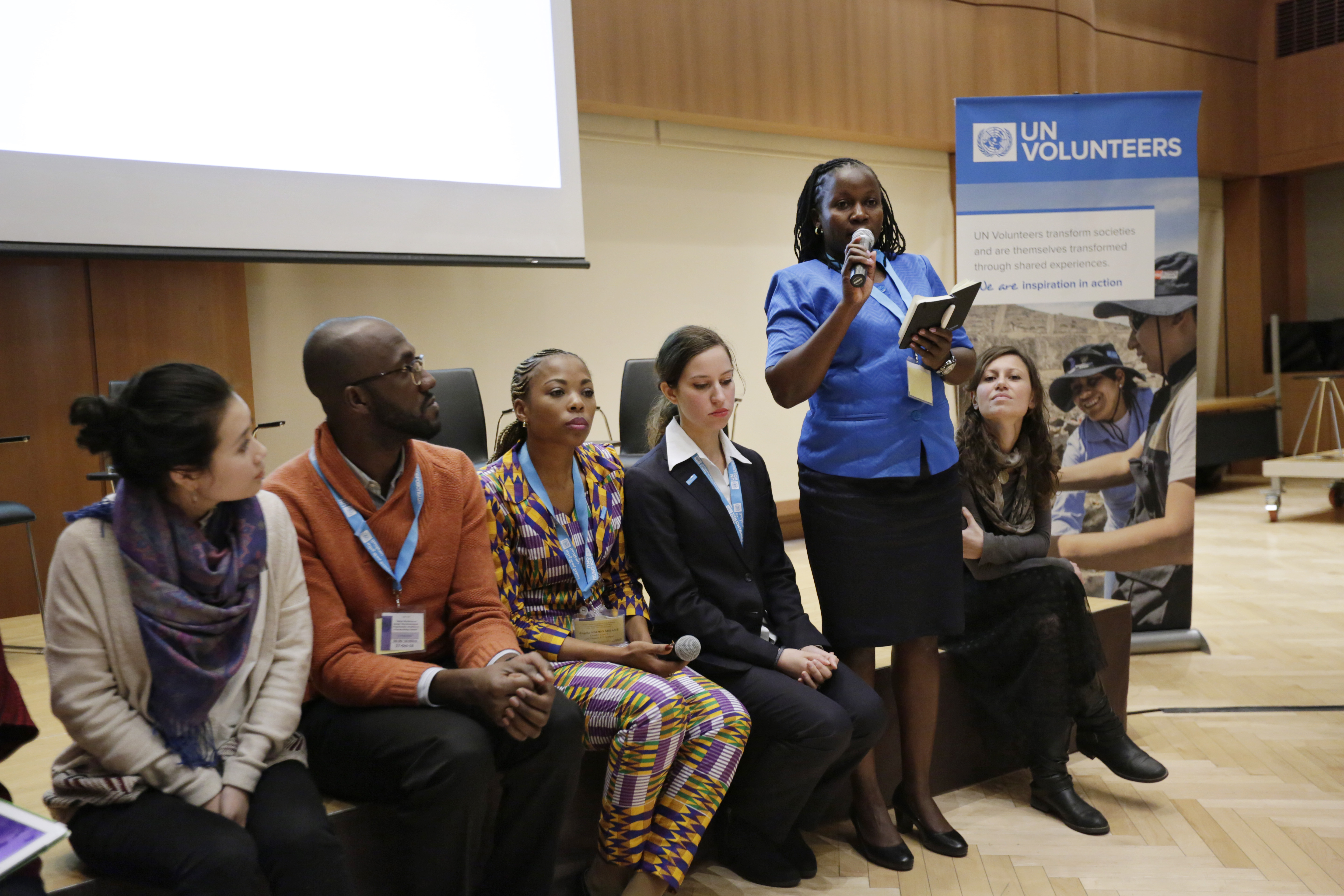 Judith Otieno, international UN Volunteer Gender Programme Analyst, speaks during the side event 'Women, Peace and Volunteerism: Partnerships for Sustaining Peace' held at the Permanent Mission of Germany to the UN.