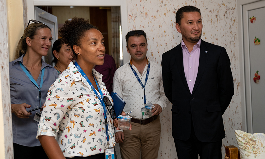 Toily KurbanovUNV Deputy Executive Coordinator Toily Kurbanov (right) and UNV Civil Engineer Gladys Gbegnedji (center-left) visit a newly rehabilitated home in Bartella, Iraq.