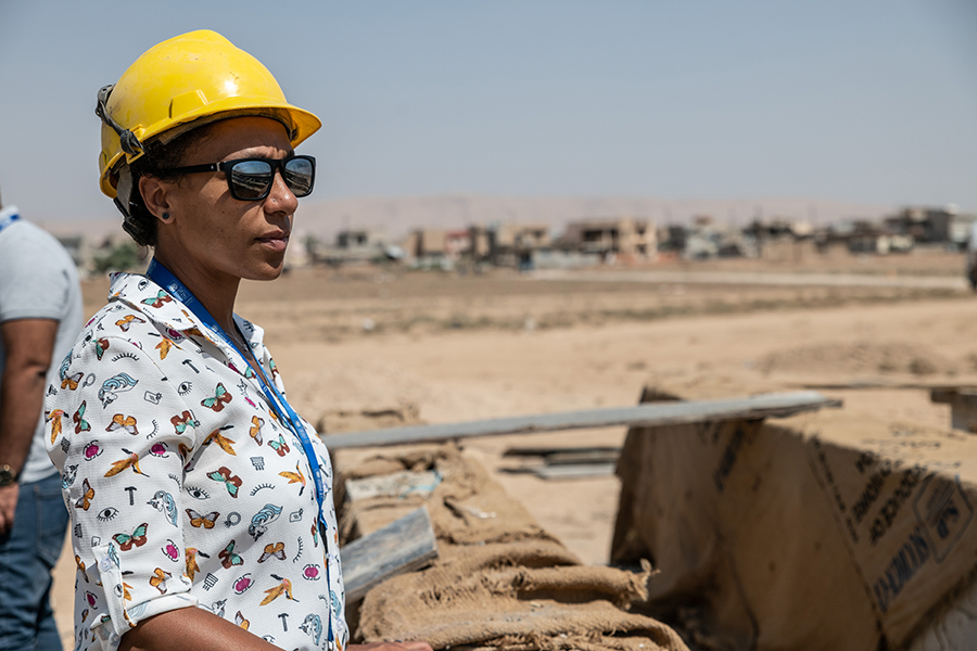 In Iraq, 15 UN Volunteers like Gladys Gbegnedji (Spain, left) review and improve construction designs and develop technical tender documentation. They support dozens of Iraqi engineers by ensuring adequate contract management and monitoring.