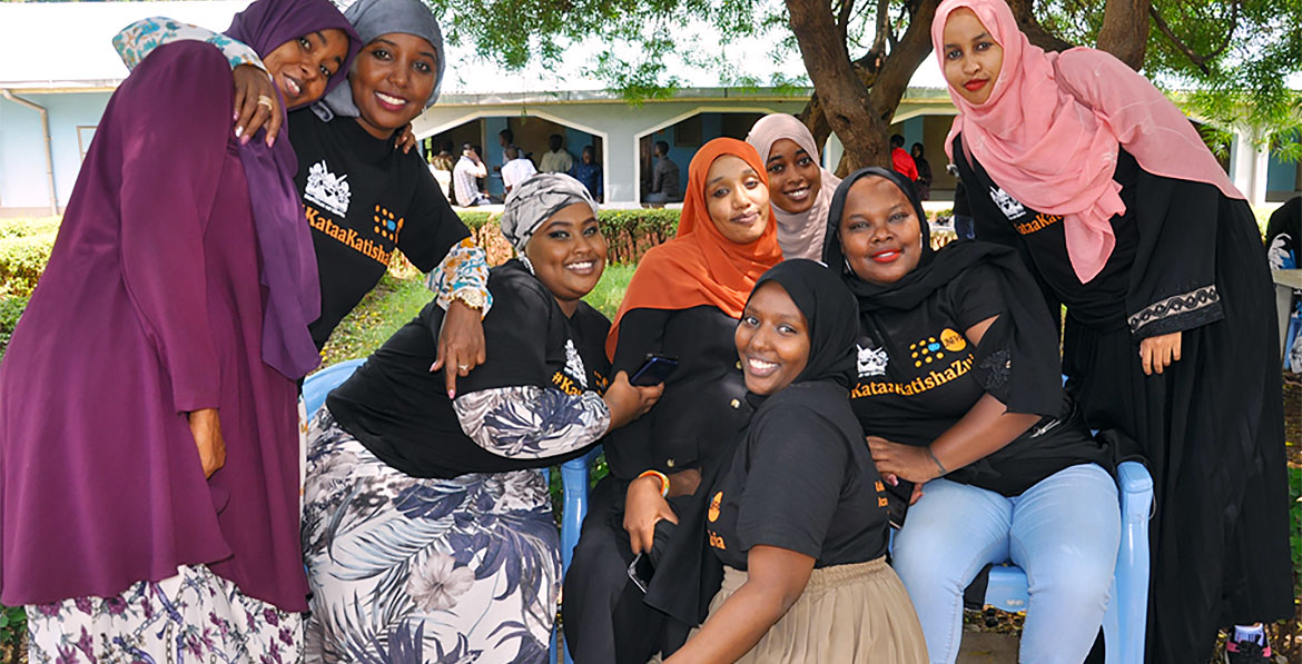 Aisha Hussein (centre, with orange scarf) and her team from Every Girl's Dream pose for a picture during the anti-FGM youth caravan in Isiolo county, Kenya.
