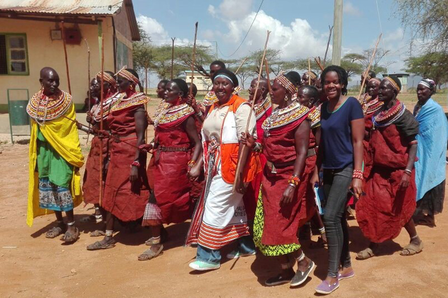 UN Volunteer Child Protection Officer with UNICEF, Faith Manyala, with women from Samburu community during a declaration ceremony to support the abandonment of female genital mutilation (FGM) in a bid to protect children from harmful cultural practices.