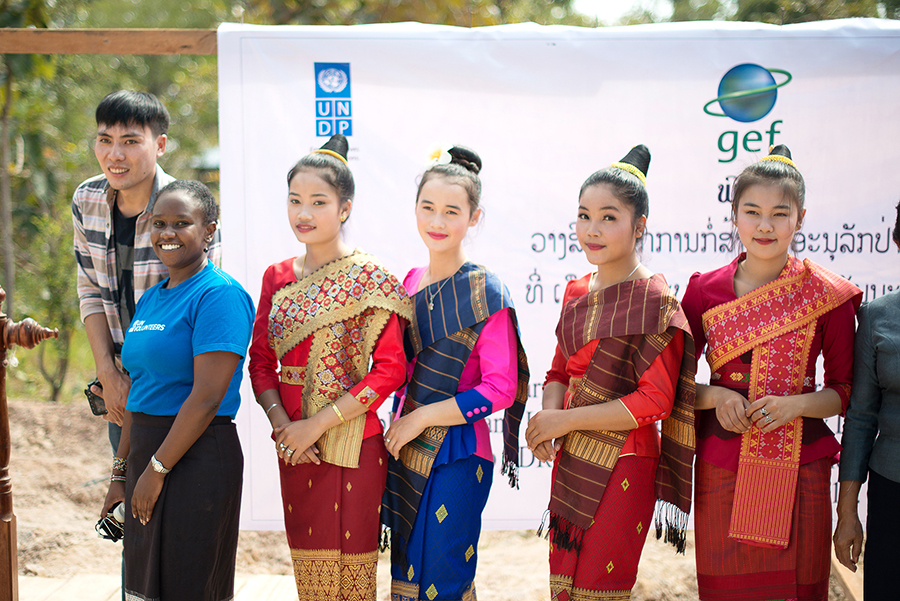 UN Volunteer, Monitoring and Evaluation Officer, Norah Ngeny (Kenya) poses with local Lao women at the ground breaking ceremony, in Ban Xanamsay Village, Lao PDR