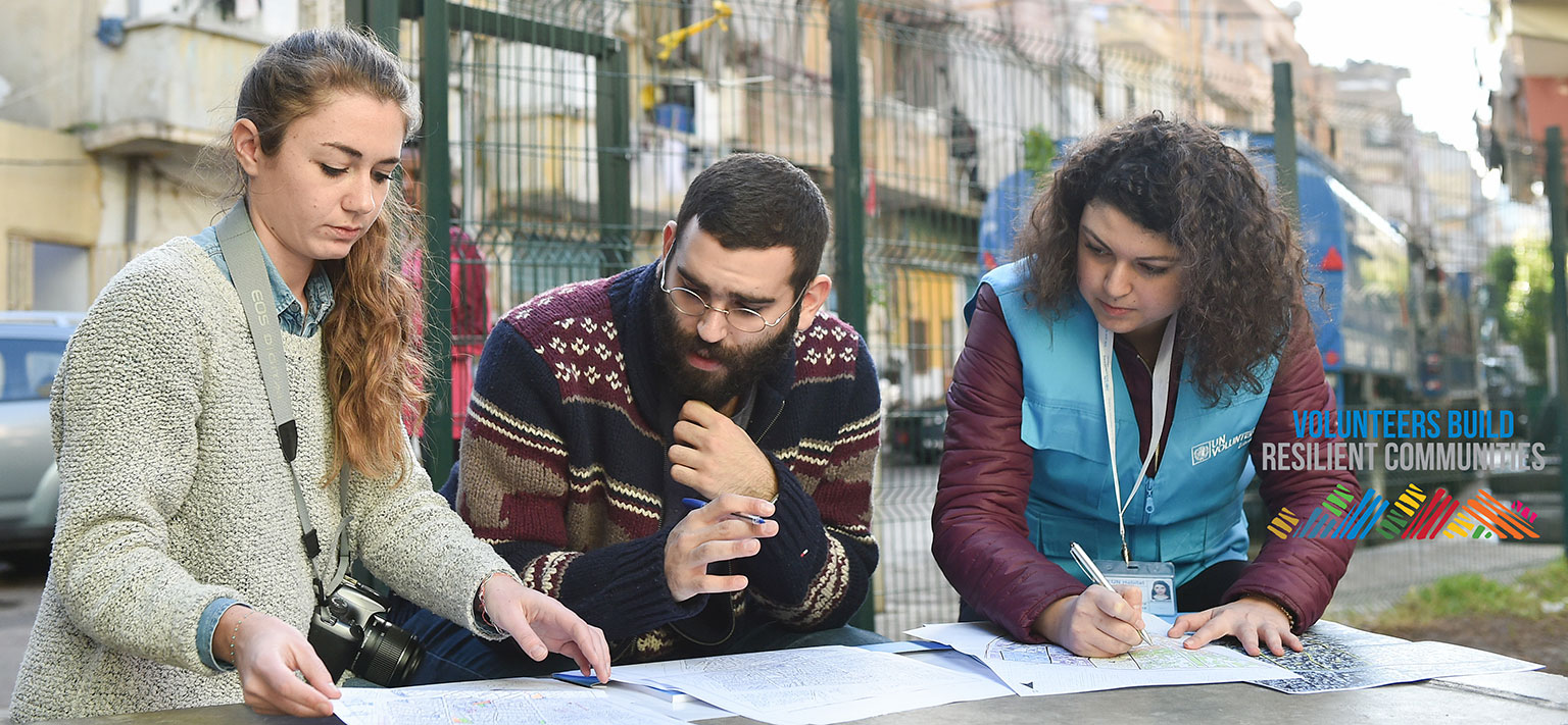 National UN Volunteer GIS Assistant, Racha Serhal (first from right), working with two UN-Habitat staff members on locating and mapping landmarks and other open spaces in Nabaa city, Beirut, Lebanon. (UNV, 2017)