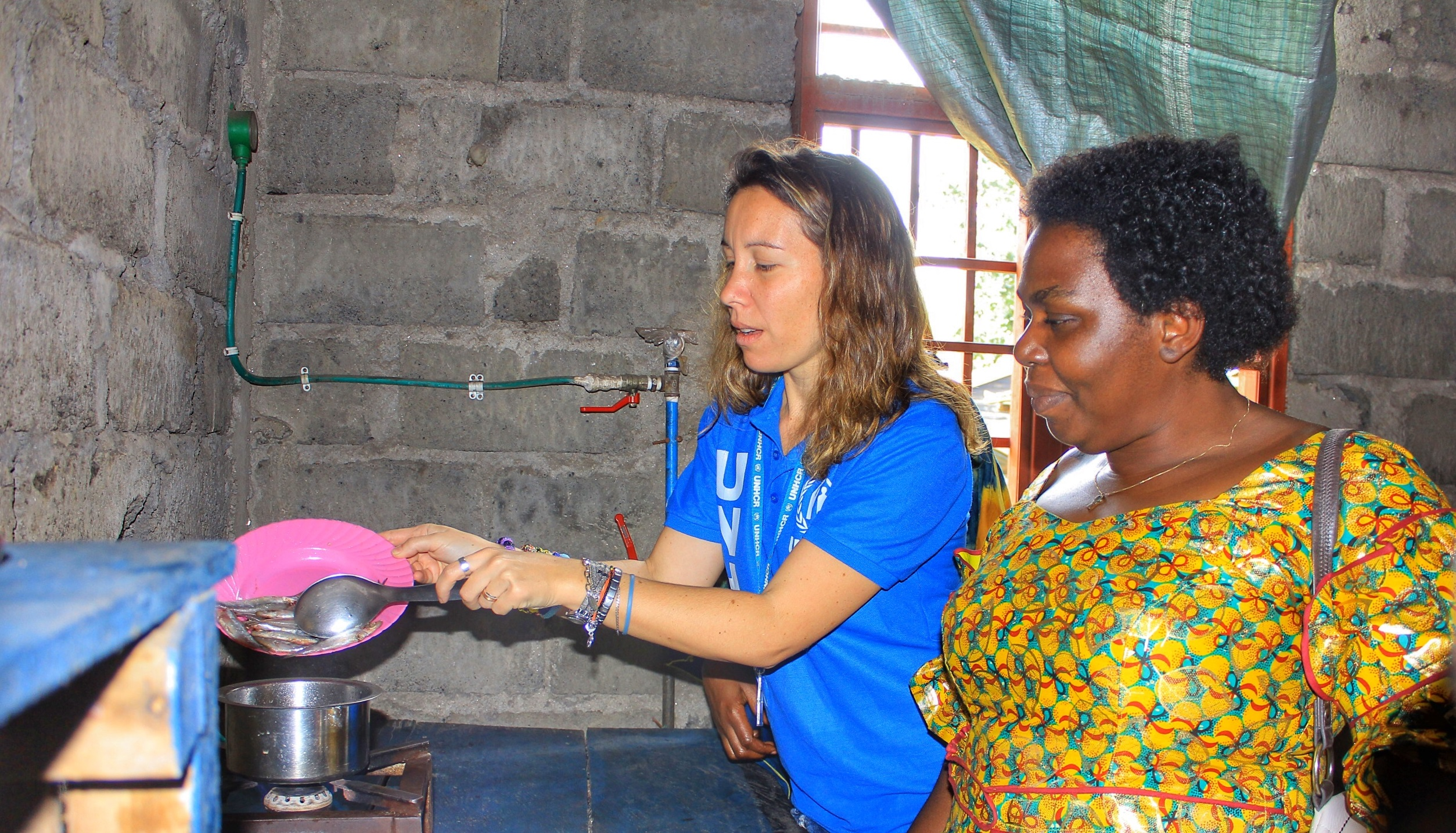 UN Volunteer Serena testing a biogaz installation in the framework of the 'safe access to fuel and energy' approach to reduce environmental impact of cooking needs through the production and use of durable clean energy. Credits UNH