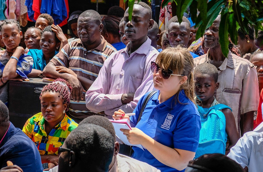 UN Volunteer Monitoring and Evaluation Officer Stella Vellendi at the ceremony to reveal the foundation stone of a borehole at Masia Market in Yambio, South Sudan.