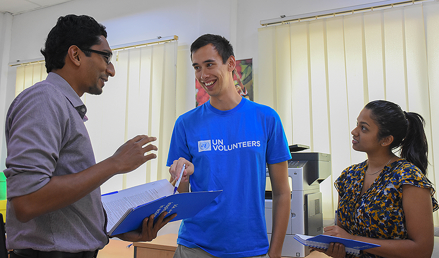 UN Volunteer Emergency Response Coordination Assistant, Alex Suwitra (Australia, centre) discussed humanitarian support in disaster situations with colleagues.