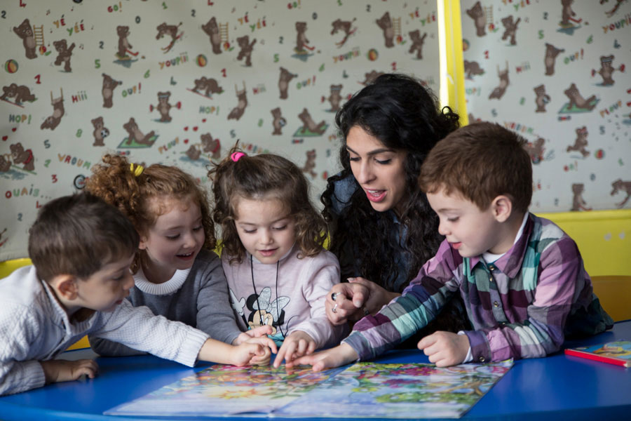 Rana Awad, national UN Youth Volunteer with UNICEF in an activity with kindergarten children, State of Palestine.