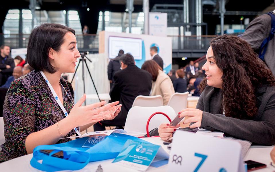 UN Youth Volunteer Ekin Su Yilmaz at the Paris Peace Forum presenting UN Women Turkey's SADA Women's Cooperative in Paris, France