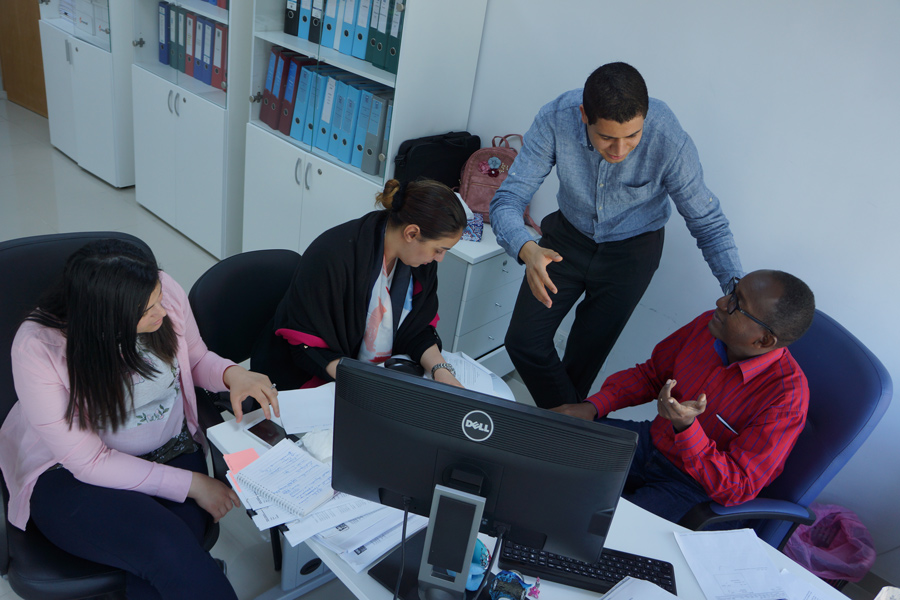 UN Volunteer Ghazi Mabrouk with colleagues at UNDP Libya office