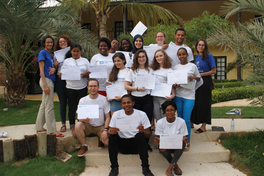 15 Youth UN Volunteers with their certificates at the end of the regional workshop – trainers in blue: Renata (left) and Ouarda (right) @UNV 2018