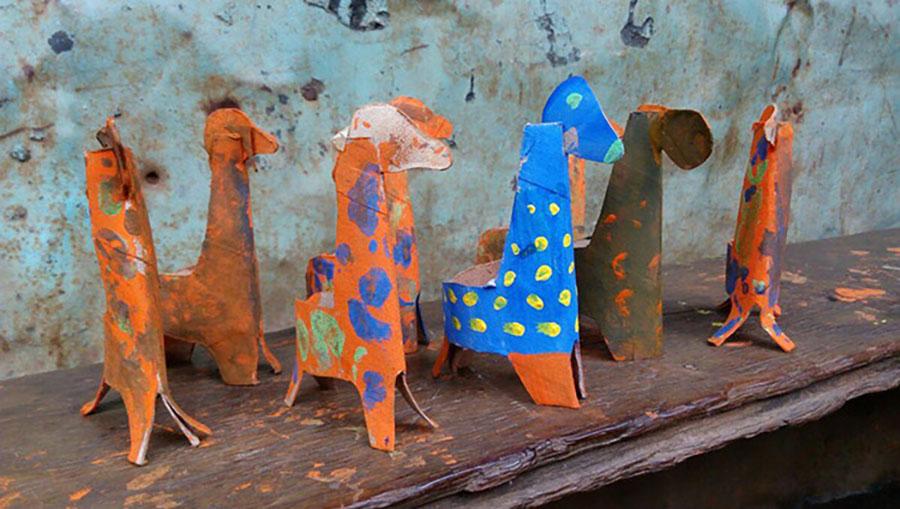 Paper giraffes made by children.