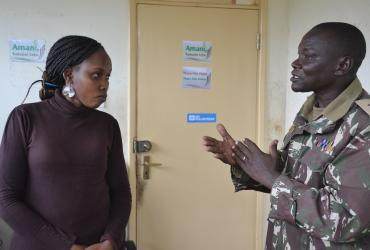 UN Volunteer Annastacia Some (left) discusses plans to ensure a peaceful election with an administration police officer.