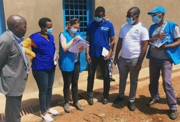 Eve Zorawska (third from left), UN Volunteer Associate Site Planning Officer with UNHCR Burundi, during field operations.