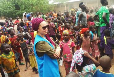 UN Volunteer Associate Field Protection Officer with UNHCR, Bouchra Makhlouf, with refugees from the Central African Republic in Goré refugee camp, Chad.