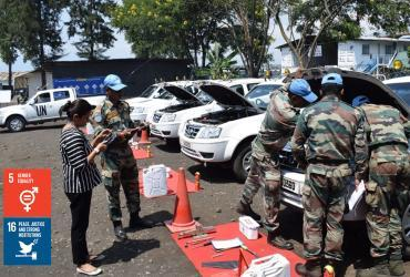 UN Volunteer Database Assistant Shahin Praveen (India) serves with MONUSCO. Here, she is seen inspecting contingent-owned equipment in Goma, DRC.