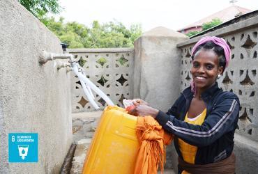 In Eritrea, a lady fetches water in Debub region.