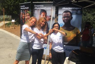 UN Volunteer Kamilia Lahrichi (centre) served as UN Volunteer Associate Public Information Officer with UNHCR in France.