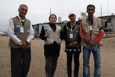 Volunteers of Handicap International in Domiz camp in Iraqi Kurdistan