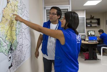 Andrea Cuisana (right), national UN Volunteer Specialist, Project and Camp Management Assistant, and David Barreno, national UN Volunteer Specialist, Procurement and Logistics Assistant, served with IOM in Manta, Ecuador.