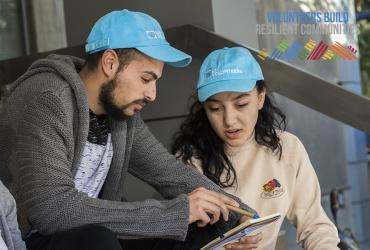 Two young Roma community members serving as UN Volunteers in their communities in Serbia.