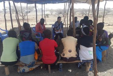 Akie Tanaka, UN Volunteer Associate Field Officer with UNHCR in Kakuma, camp, Kenya, during a focus group discussion in the community.