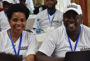 Castro Barasa (right), one of the 12 UN Volunteer Peace Coordinators, during the Kenya Government induction training with one of the 200 government-recruited peace monitors.