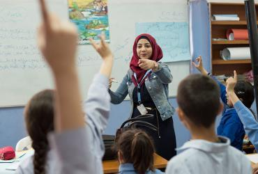 UN Volunteer Teacher Sanaa Hussein, during her Arabic lesson, interacting with her students of grade 3.Sanaa is a refugee from the State of Palestine, and teaches Palestinian student refugees twice displaced to Lebanon from Syria.