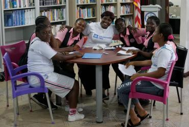 Ruth Cleopatra Engmann, UN Volunteer Liaison Officer assigned to the Resident Coordinator's Office, during a group discussion with school girls in Grand Bassa County, Liberia.