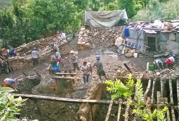 Rajendra with a team of volunteers clearing debris in Nepal (2015).