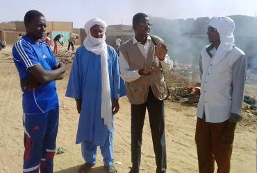National UN Volunteer Hassane Abdoulsalamou with youth engaged in the project.