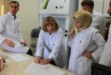 Forensic expert from the Palestinian Forensic Laboratory working analysis of samples of drugs and chemicals