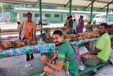 UN Volunteer Jacinta Nakachwa at the Kopi market in Port Moresby.