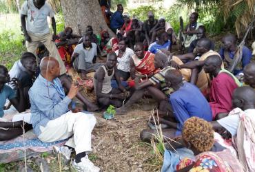 Volunteers UN Volunteer Pastoralist Literacy And Education Specialist  Solomon Bekele (centre) Serves With UNESCO In