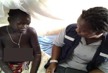 Midwife in South Sudan with patient.