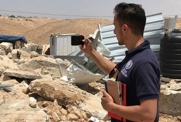 Abdelrahman Salayma, national UN Volunteer with OCHA in the State of Palestine, assessing a demolition site in Hebron.