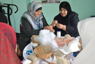 Shahd El-Swerki (left), national UN Volunteer Communications Assistant at UNDP Gaza, visited a cancer care centre and joined women volunteers in sewing breast prosthetics, which are distributed for free to female cancer patients.