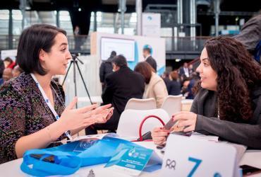 UN Youth Volunteer Ekin Su Yilmaz at the Paris Peace Forum, presenting UN Women Turkey's SADA Women's Cooperative in Paris, France.