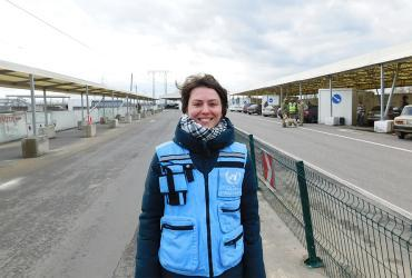Iryna Koval, national UN Volunteer, during a visit of the inter-cluster coordination groupto the Mariinka checkpoint in eastern Ukraine.