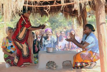 Women in Matebo Village in Kalumbila District, Zambia, try out their new energy-saving stoves .