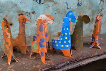 Paper giraffes made by children.